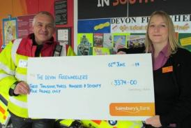 Sainsbury's handing over cheque