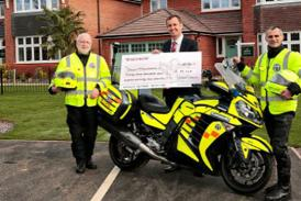 Bikers with cheque