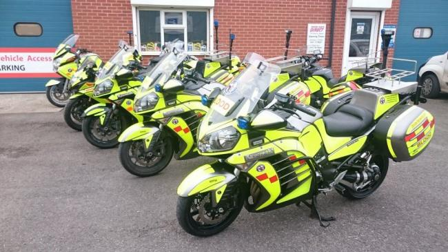Five blood bikes stood up in a row