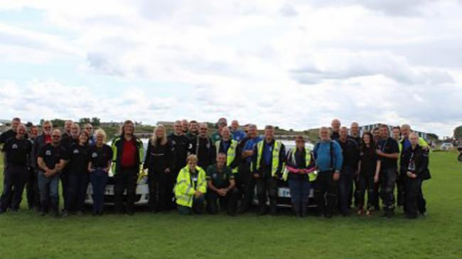 Group photo of all riders and support volunteers